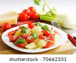Potato salad in the soup-plate with fork - stock photo