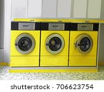 Small photo of Automatic launderette with yrllow washers to washing dirty cloths