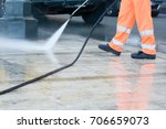 a worker with a pressure washer ... | Shutterstock . vector #706659073