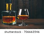 glass of brandy or cognac with... | Shutterstock . vector #706663546