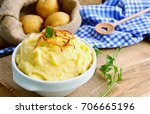 mashed potatoes or puree in... | Shutterstock . vector #706665196