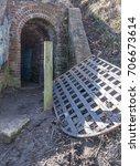 a metal door lays on the ground ... | Shutterstock . vector #706673614