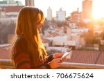 smiling woman on the balcony in ... | Shutterstock . vector #706675624