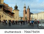 tourists walk through rynek... | Shutterstock . vector #706675654