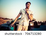 stylish young man standing next ... | Shutterstock . vector #706713280