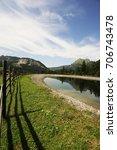 wooden fence in the alps under... | Shutterstock . vector #706743478