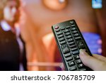watching tv and using remote... | Shutterstock . vector #706785709