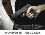 a man holding a gun in hand ... | Shutterstock . vector #706822306