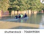 people in a motor boat ride... | Shutterstock . vector #706849084