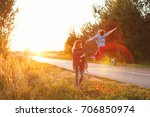 a couple at a country road. he... | Shutterstock . vector #706850974