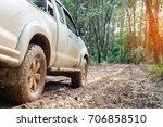car wheels on a gravel road in... | Shutterstock . vector #706858510