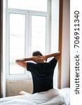 man feeling back ache in the... | Shutterstock . vector #706911340