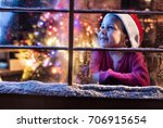 on christmas night a little... | Shutterstock . vector #706915654