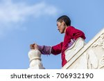 a nun in lharong monastery and... | Shutterstock . vector #706932190