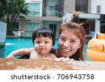 the kid and mom play together... | Shutterstock . vector #706943758