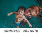 the kid and mom play together...   Shutterstock . vector #706943770