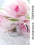 Pink rose and wedding ring - stock photo