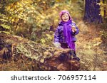 little girl in the autumn... | Shutterstock . vector #706957114