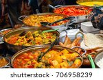 variety of cooked curries on... | Shutterstock . vector #706958239