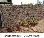 gabione  fence  gates  wall | Shutterstock . vector #706967026