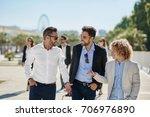 three happy businessmen having... | Shutterstock . vector #706976890
