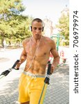 fit man exercising at the park  ...   Shutterstock . vector #706979974