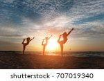 the group of women doing yoga... | Shutterstock . vector #707019340