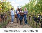 young women friends harvesting... | Shutterstock . vector #707028778