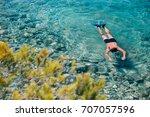 young man snorkeling in...   Shutterstock . vector #707057596