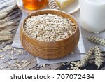 bowl full of oats with milk and ... | Shutterstock . vector #707072434