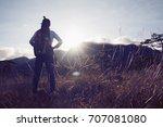 hikers women walking through a... | Shutterstock . vector #707081080