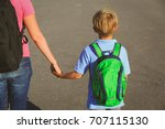 back to school   mother holding ... | Shutterstock . vector #707115130