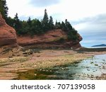 Small photo of Low tide at the Caves on the Fundy coast in the Atlantic ocean in Saint Martins, New Brunswick, Canada