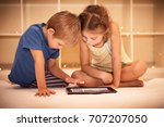 two happy children playing on... | Shutterstock . vector #707207050