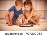 two happy children playing on... | Shutterstock . vector #707207053