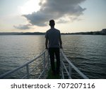 silhouette a man on sunset | Shutterstock . vector #707207116
