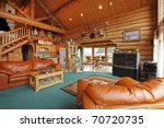 Large living room of the log cabin with cowboy style - stock photo