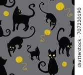 Stock vector black cats silhouettes seamless pattern vector illustration of cats with wool cloths on grey 707220190