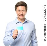 cute teenage boy with card on... | Shutterstock . vector #707222746