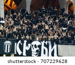 Small photo of FELCSUT, HUNGARY - AUGUST 24, 2017: The ultras of FK Partizan incite their team during Videoton FC v FK Partizanthe UEFA EL match at Pancho Arena.