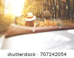 young couple in retro cabrio... | Shutterstock . vector #707242054