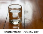 drinking glass on wooden table   Shutterstock . vector #707257189