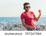 young man listening to the... | Shutterstock . vector #707267584