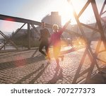 healthy young couple jogging in ... | Shutterstock . vector #707277373