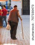 An Old Muslim Man Is Walking A...