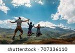 three friend jumping holding... | Shutterstock . vector #707336110