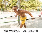 fit man exercising at the park  ... | Shutterstock . vector #707338228