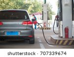 the car is fueling. | Shutterstock . vector #707339674