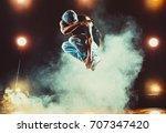 young man break dancing in club ... | Shutterstock . vector #707347420
