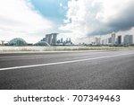 empty asphalt road and... | Shutterstock . vector #707349463